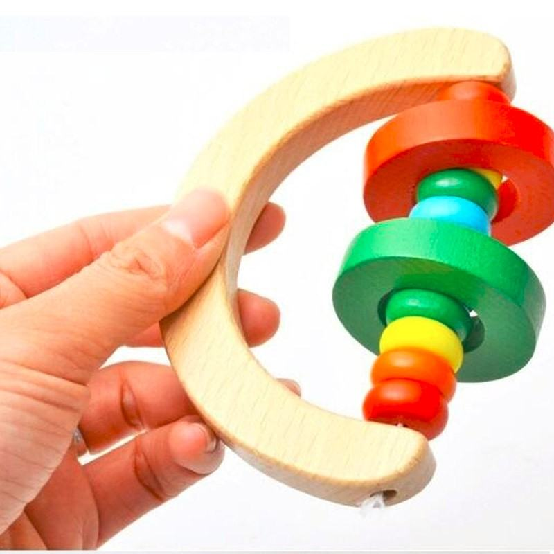 Wooden Bell baby   playing